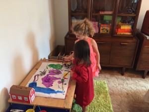 Philomena & Evelyn painting in their party dresses.